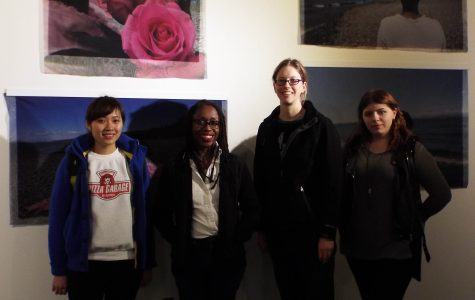 "C Davida Ingram (second from left) poses with students in front of a set of four pieces printed on fabric, titled ""Lexical Tutor."""