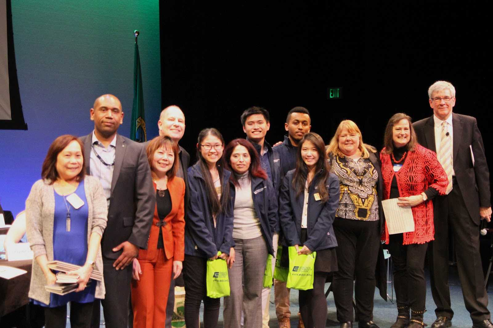 (from left) Edmonds CC employees Lynne Rigoroso, executive assistant;  Dan White, Paralegal instructor; Marie Tran, Business Management  instructor; Wayne Anthony, director of the Center for Student Engagement  and Leadership; Ethics Challenge team members Linh Tran, Maria French,  Tri Minh Do, Natch Sriwongthai, and Naol Debele; Dr. Terry Cox, vice  president of Workforce and Development and Training; Kathryn Wyatt,  Boeing staff analyst; and Charles Ruthford, master of ceremonies.