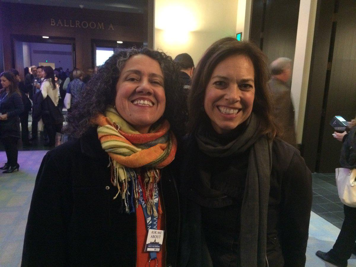 Dr. Astrid Caldas (left) poses for a photo with Lisa Palmer (right) at the 2017 American Association for the Advancement of Science annual meeting.