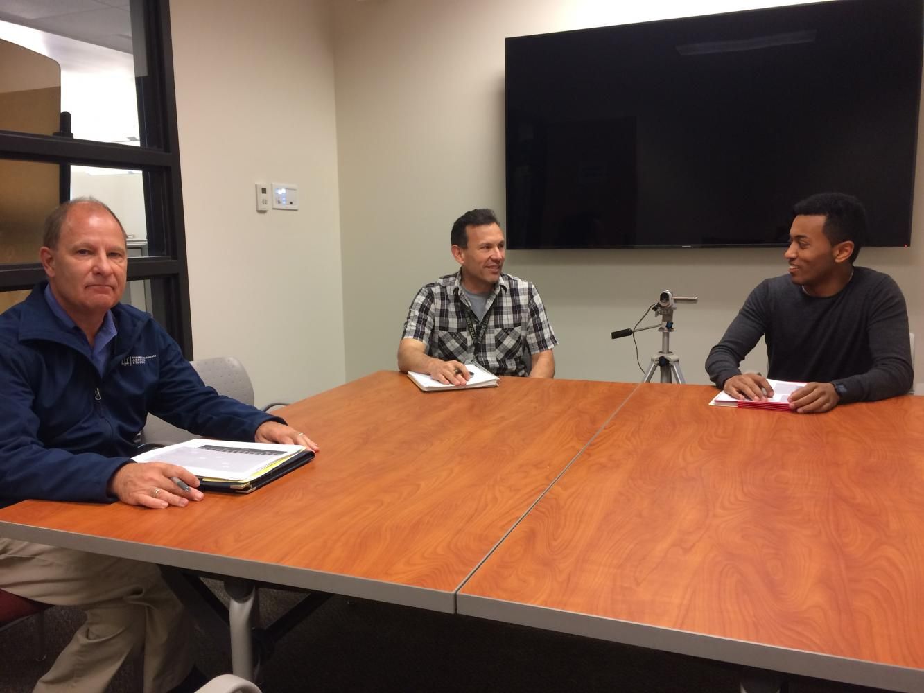 Members of the executive officer committee convened on June 8, preparing to interview an executive board candidate. Naol Debele (right) and Jorge de la Torre (center) chat while Wayne Anthony (left) solemnly regrets cheeky grins and retorts of bygone days.