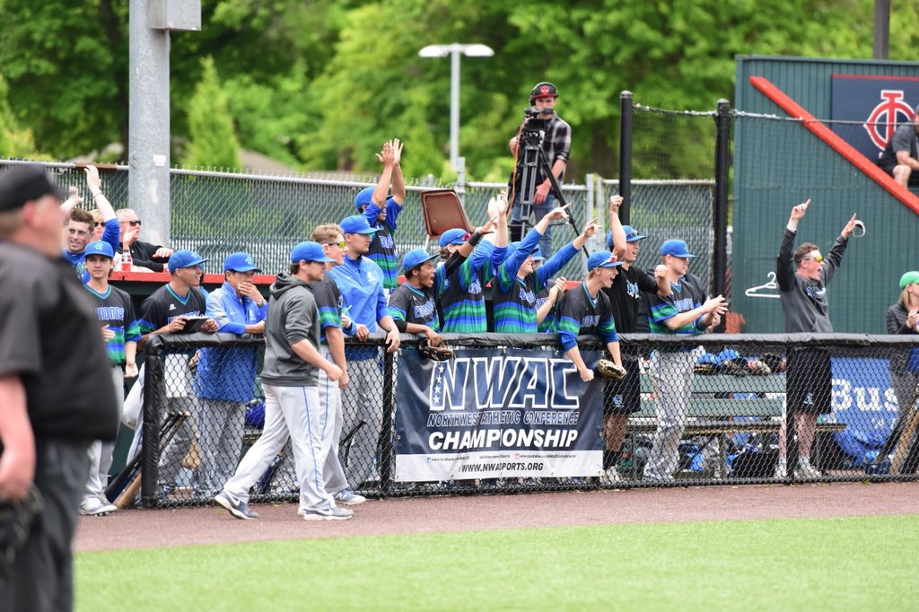 The EdCC Triton baseball team on the sidelines, cheering during a home game. The team won plenty of NWAC North Region All-Star titles during the season.
