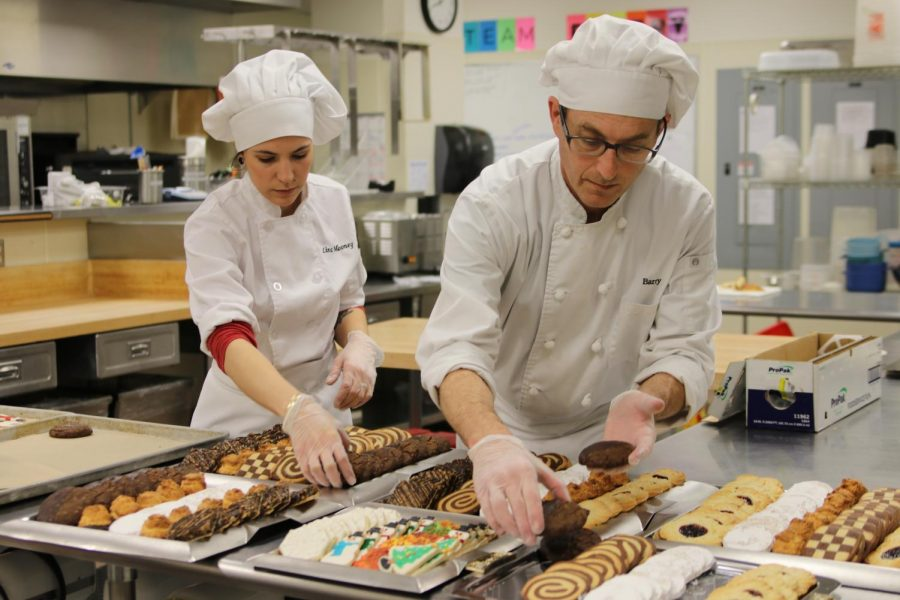 Culinary students Carolina Mooney and Barry Rickman working hard to complete their cookies.