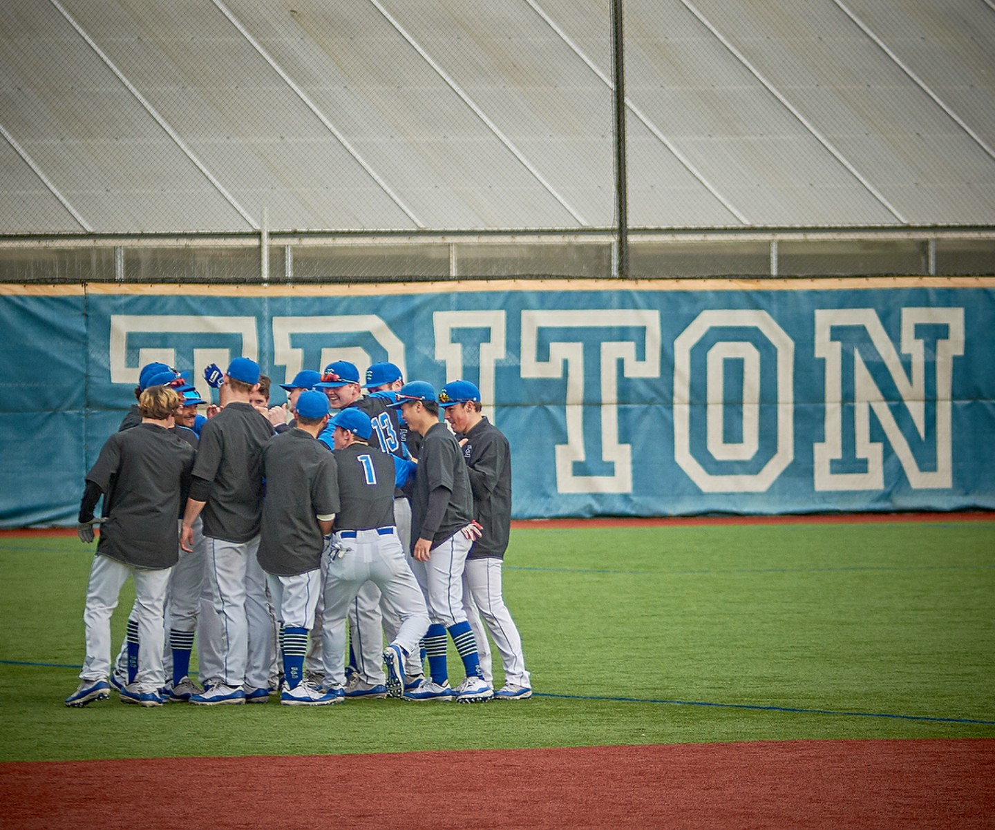 The Tritons, huddled together for a team chant before their game.