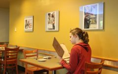 Madeleine S. Jenness ponders what to order during her very first visit to the cafe.