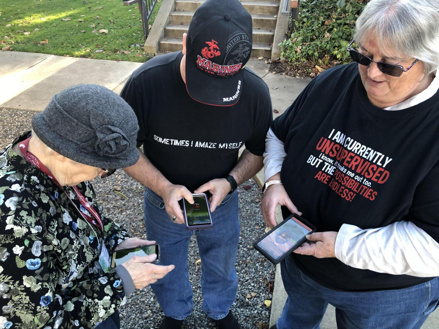 (Left to right) Marge, Michael and their friend Lynn playing Pokemon GO at Heritage Park.