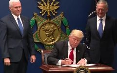 U.S. President Donald Trump signing Executive Order 13769 flanked by Vice President Mike Pence (left) and Secretary of Defense James Mattis.