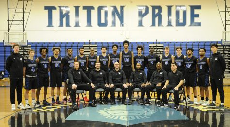 The Triton men's basketball team pose for a team photo.